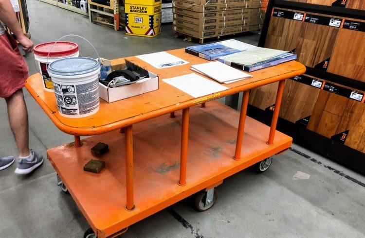 orange Home Depot cart holding backsplash supplies for the workshop