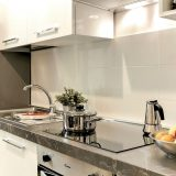 view of white kitchen with white tile backsplash