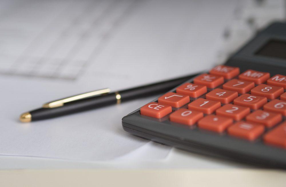 calculator with orange keys on table