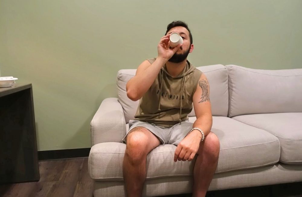 Mike drinking water in the decompression lounge