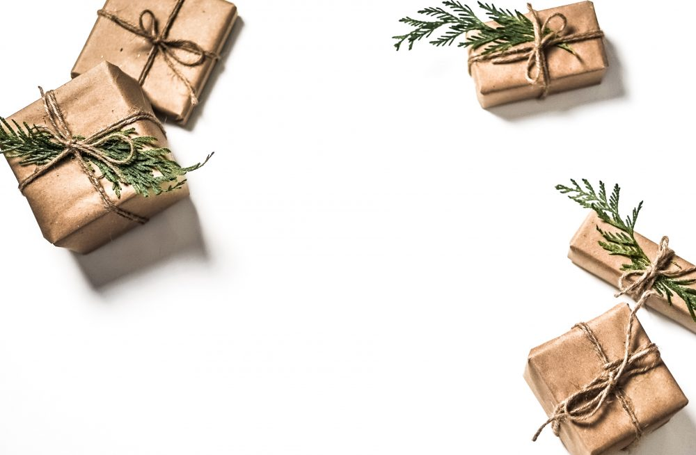 christmas presents wrapped in brown paper and tied with brown sting and twigs