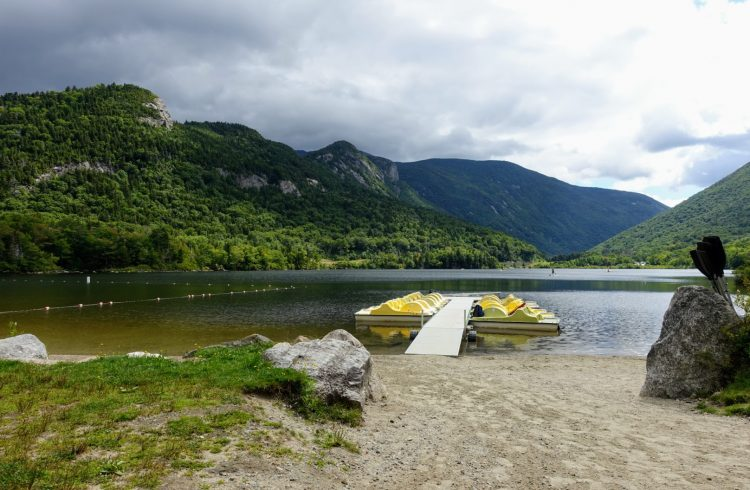 paddleboats at Echo lake beach with views of the mountains