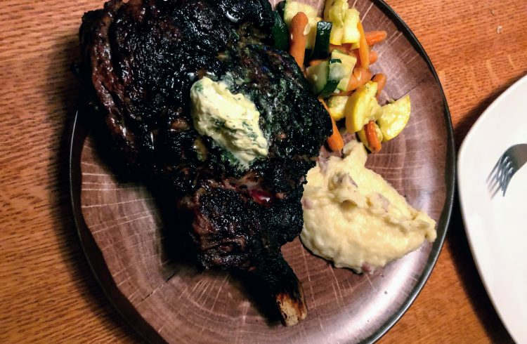 plate of steak with mashed potatoes and mixed vegetables