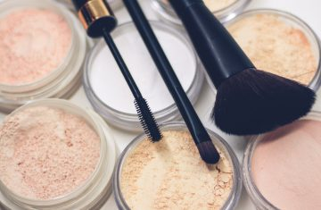 makeup brushes laying on makeup powders